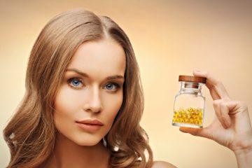 Витамин Е для кожи лица в руках у девушки